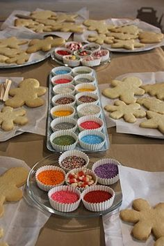 What a cute idea!!! Christmas - holiday cookie workshop! (icing is in cups with popsicle sticks for spreading) perfect to do with all of the kids in the family this year!