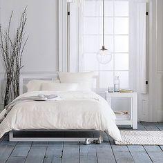West Elm / bedroom / floor / white / plant / decor / lighting / lamp / scandinavian