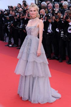"Diane Kruger wore a Dior Haute Couture ""Dior grey"" lace tiered ball gown to the 70th Anniversary Ceremony during the 2017 Cannes Film Festival. She's also wearing a choker and carrying an astrological clutch by Dior & Chopard jewelry (II)"