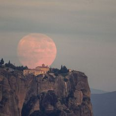 Hunter's Moon rising behind the Metéora monastery in Greece. It's one of the largest and most important complexes of Greek Orthodox monasteries in Greece, second only to Mount Athos. | Image credit: Aimilianos Gkekas | More images: http://earthsky.org/todays-image/see-it-great-photos-of-hunters-moon?utm_content=buffer4aedb&utm_medium=social&utm_source=pinterest.com&utm_campaign=buffer