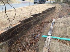 Railroad tie Retaining Wall Installation In Tulsa Railroad tie Retaining Walls…