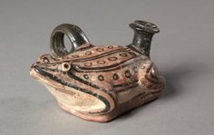 Apulian Frog Guttus, pottery with black slip and added white. South Italy, Apuila, 4th century BC - The Cleveland Museum of Art