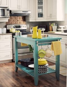 Pop of color in a small kitchen- I love these mini islands that I could DIY