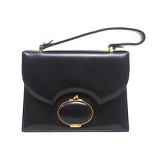 BLACK LEATHER 1960S HANDBAG WITH EXTERIOR MIRROR | From a collection of rare vintage handbags and purses at http://www.1stdibs.com/fashion/accessories/handbags-purses/