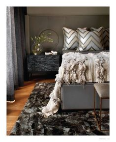 Fix the headboard so it stretches across the wall to make the room seem wider. This generosity also adds a luxurious feel.