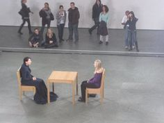 Marina Abramović sitting with Rebecca Taylor atThe Artist is Presentperformance at The Museum of Modern Art, 2010