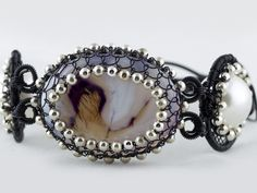 Netting with metallic beads to add sparks to your cabochon stones. This cuff style is edgy yet maintains a classic black look.