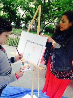 Young girl expressing what it means to have a second chance of life through her artwork