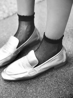 Fishnet Socks | Italian made classic fishnets ankle socks featuring an elastic band at the opening with a ruffle trim.