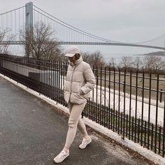 Winter white puffer coat, lounge pants, baseball hat #athleisure #wintercasual