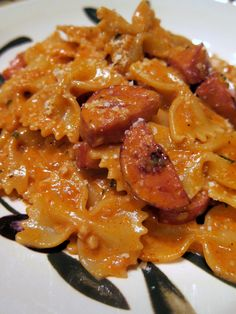 Creamy Jambalaya Pasta  Farfalle,   sausage,   cream,   garlic,   onion,   cajun seasoning,   white wine,   tomato sauce,   parmesan cheese