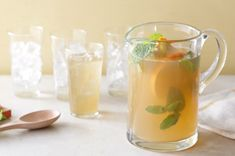 Break out the bourbon and break off a few sprigs of fresh mint. This citrusy ginger punch is the perfect sip to enjoy whilst watching the Kentucky derby. Party Drinks, Cocktail Drinks, Fun Drinks, Yummy Drinks, Alcoholic Drinks, Cocktails, Beverages, Holiday Drinks, Yummy Food