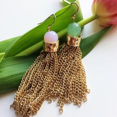 Repin this beauties if you love them!! Gorgeous #Mismatch #Tassel #Earrings are  available to shop only for £10.00 @missworldlondon on @asosmarketplace https://marketplace.asos.com/listing/earrings/mismatch-long-tassel-gold--earrings-with-green-pink-stone/2909960