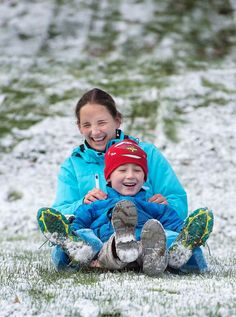 The first accumulation of snow, maybe an inch, dusted Gig Harbor Saturday morning, November 29, 2014 and immediately families with kids sprung into action at Sehmel Homestead Park.