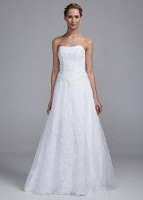Sweet and classic design, this strapless organza gown is truly enchanting! Strapless Organza A-line gown features stunning lace appliques on bodice and skirt. Delicate and eye-catching lace hemline finishes off the look. Available online in White. Fully lined. Back zip. Imported polyester. Dry clean.