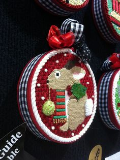 photo Rabbit Christmas Ornament Needlepoint Christmas ornament design from Melissa Shirley Designs. From the Kreinik booth at the TNNA needlearts industry trade show, February 2013 in Long Beach, California.