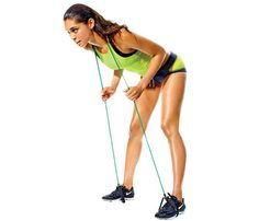 Resistance Band Workout: Work butt, lower back and hamstrings with the 'Booty Boost.' Step into handles with feet hip-width apart and loop band over back of neck. Hold band at chest height, elbows bent. Push hips back and slowly bend forward, keeping back straight and knees soft (as shown). Return to start. Do three sets of 12 reps. #SelfMagazine