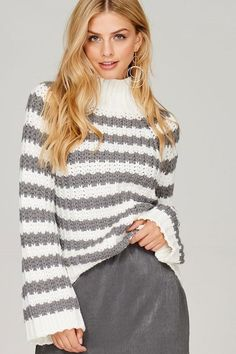 From our Sakora Linn Fall + Winter Style Collection, we love this chunky mock turtleneck sweater with striped pattern and bell sleeves in dove white/grey. - Acrylic - Available in sizes S/M, M/L Autumn Winter Fashion, Winter Style, Fall Winter, Marina Laswick, Canadian Models, Winter Collection, Photography Poses, Pullover Sweaters, Bell Sleeves