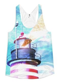 Quoddy Lighthouse – Women's Racerback Tank // Axly // An electrified West Quoddy Head Light illuminating the easternmost point in downeast Maine. The candy-striped lighthouse and spotlight is surrounded by cerulean blue skies. Flattering A-line cut. 100% polyester jersey. Made in USA.