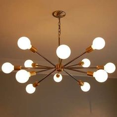 With its starburst of light, this Sputnik-style chandelier evokes mid-century modern, while the copper rods and exposed Edison light bulbs give it a certain industrial edge. The fixture marries well with clean lines and a simple color palette.