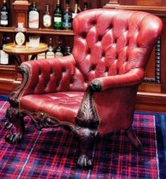 Tufted red leather library chair