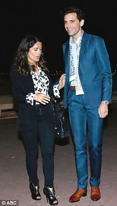 Mika and Salma Hayek leaving a restaurant in Cannes May 2014