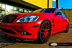 """The red Mercedes-Benz S Class below is showing off a bright red finish, a Lorinser body kit and the luxury high performance wheels """"Giovanna Kilis"""". The Kilis rims have a custom paint job but are also available in chrome, black and machined (sliver & black) finishes. The luxury wheels are also available in different sizes including 20X8.5, 20X10, 22X9 and22X10.5 inches. #Mercedes #Cars #Rides #Auto #iAUTOHAUS"""