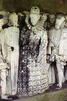 Queen Elizabeth I and leading figures from her court. From a carving in the gardens of Hatfield Place, her childhood country home.