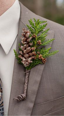 Pinecone Boutonniere: Let's face it, flower boutonnieres hardly ever last throughout the day. This pinecone and evergreen combo will look just as good the night of your wedding as it did when your groom pinned it on that morning. | 10 Gorgeous Evergreen Wedding Arrangements