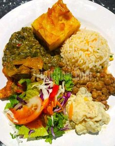 Callaloo, Fish, Macaroni Pie, Rice, Stewed Pigeon Peas, Potato Salad & Fresh Salad