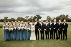 Wedding Suits wedding party with groomsmen in black tuxedos and light blue ties, and bridesmaids in dusty blue halter style gowns. the bride chose all white flowers for the bouquets. Steel Blue Bridesmaid Dresses, Blue Wedding Dresses, Bridesmaids And Groomsmen, Wedding Bouquets, Steel Blue Weddings, Dusty Blue Weddings, Groomsmen Attire Black, Groom Suits, Groom Attire