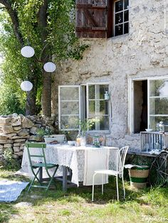 Stunning Decoating Outdoor Patio With Dining Table Set On Green Grass As Well Lampion Hang On Tree Along With Stone Wall Decor Home Idea Get Simple Decoration: Decorating Outdoor Patios garden design http://seekayem.com