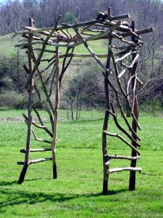 Custom made garden arbor approximately 2 ft deep, 6.5 ft tall, 5 ft wide in weathered de-barked mixed woods.