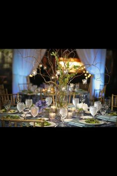 Elvish nature table centrepieces. Green and gold.