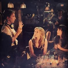 Sam Taylor Johnson, Eloise Mumford, and Dakota Johnson on set for Fifty Shades of Grey