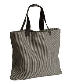 Beach bag in cotton fabric with interwoven plastic strands. | H&M Home