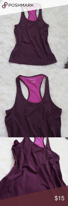 Fabletics Tank Top Really cute Fabletics tank top in excellent used condition - size large. It's a very deep purple color with some pink accents. Soft and a bit stretchy! Let me know if you have any questions!  I also have a pair of Fabletics capri leggings available in my closet that would go well with these! Fabletics Tops Tank Tops