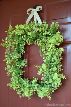 Cute and cheap spring wreath made with a picture frame as the base.