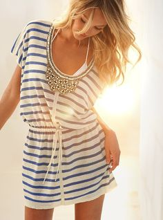 Such a cute bathing suit coverup - love the embellished neckline.