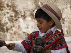 A child playing music in Antigua, Guatemala