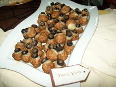 """Harry Potter food- """"troll eyes"""" - meatballs with cheese and olive slice"""