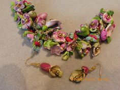 Polymer flowers, crystals, flowers painted sides with gold metallic paint, polymer butterfies and ladybugs.