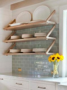 pale wood open shelving with upside down brackets plus a soft grey green mint subway  tile | Dearborn Builders | Tory Haynes Interiors