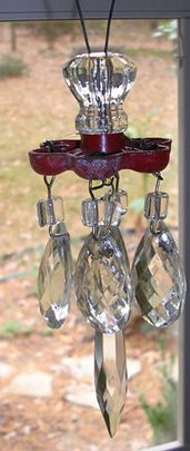 Garden bling using faucet handles, glass knobs, prisms all wired together!