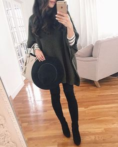 casual winter outfit // olive green poncho sweater, striped tee, black jeans & boots, wool hat