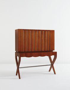 GIO PONTI Illuminated drop-front writing desk, circa 1948  Mahogany-veneered wood, sycamore, chromium-plated tubular metal, glass. 50 5/8 x 43 3/4 x 17 5/8 in. (128.6 x 111.1 x 44.8 cm)