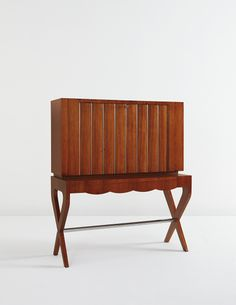 GIO PONTI Illuminated drop-front writing desk, circa 1948 Mahogany-veneered wood, sycamore, chromium-plated tubular metal, glass. 50 5/8 x 43 3/4 x 17 5/8 in. (128.6 x 111.1 x 44.8 cm)