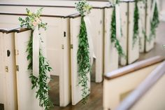 Lauren and Thomas' organic, rustic floral decorations were the perfect contrast to our building's symmetry.   Congratulations to Lauren and Thomas! Photography by: Shane Godfrey