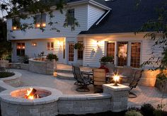 Patio with fire pit. I like how half the fire pit is surrounded by the patio. Might have to do without the wall Back Patio, Backyard Patio, Backyard Landscaping, Nice Backyard, Patio Wall, Small Patio, Diy Patio, Patio Decks, Deck To Patio Ideas