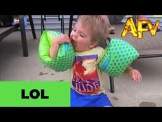 This Boy Trying To Eat A Cookie While Wearing Floaties Is The Definition Of The Struggle